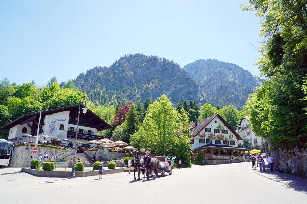 Vllage of Hohenschwangau with horse drawn carriages in the street