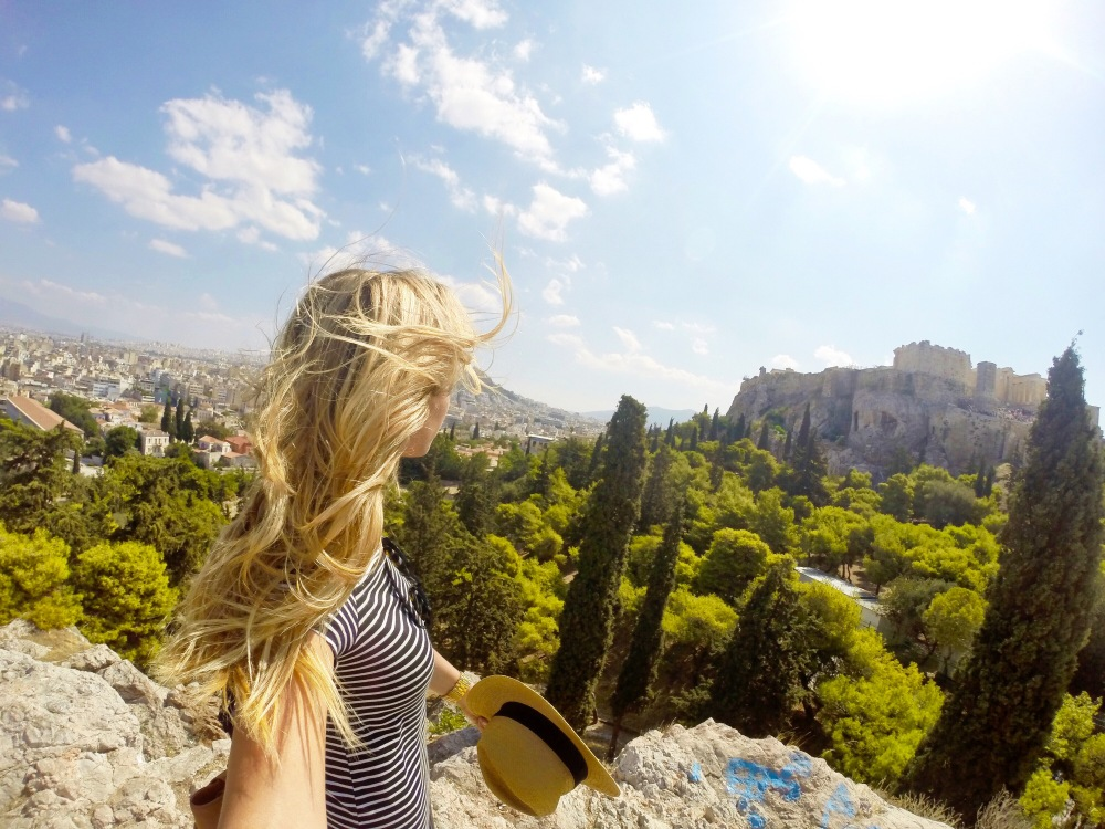 blonde hair blowing in the wind on Areopagus Hill
