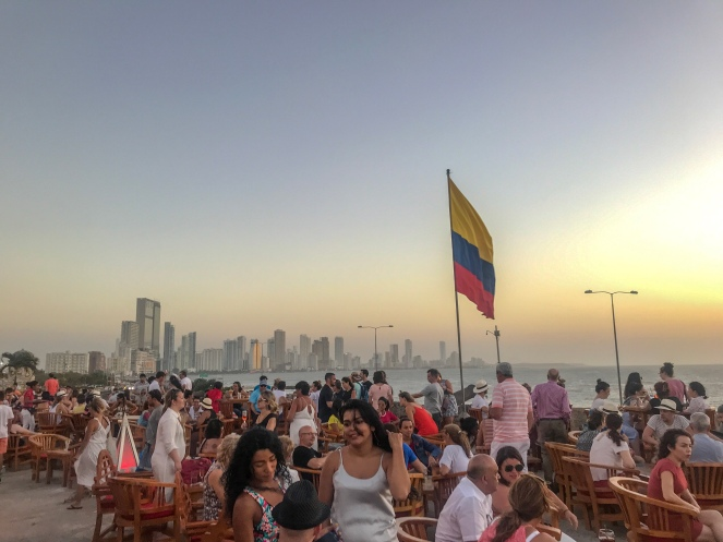 Sunset at Cafe Del Mar with Colombian flag